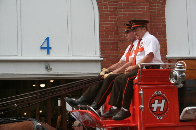 Hallamore Clydesdale drivers - notice the number of reins in the driver's hands.